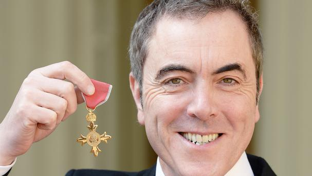 James Nesbitt with the OBE he was awarded by the Queen at Buckingham Palace