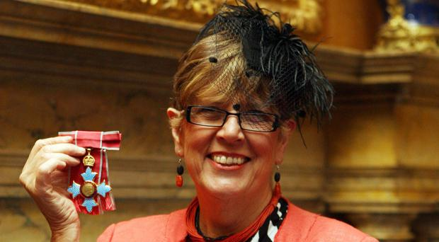Prue Leith with her CBE at Windsor Castle - she is reportedly being lined up to replace Mary Berry on the Great British Bake Off