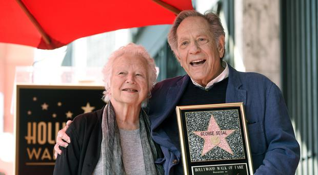Actor George Segal, right, poses with his wife Sonia during a ceremony honoring him with a star on the Hollywood Walk of Fame.