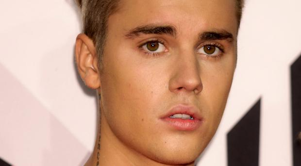 Justin Bieber said he turned while driving and water from flowers spilled on him, causing an unfortunate wet patch