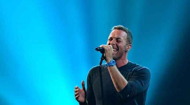 Coldplay's Chris Martin performs at the Brit Awards