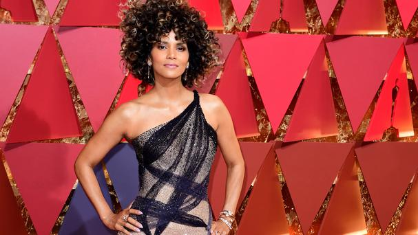 Halle Berry dazzled in a pink and black Atelier Versace gown at the Oscars in Los Angeles (AP)