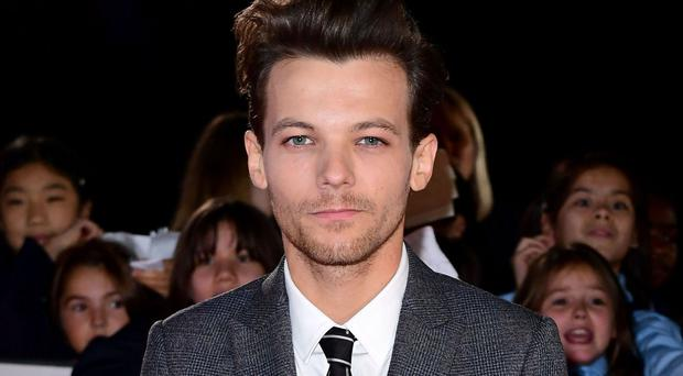 Louis Tomlinson got involved in an 'altercation' with paparazzi in Los Angeles