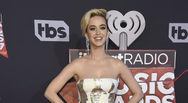 Katy Perry arrives at the iHeartRadio Music Awards at the Forum in Inglewood, California (Invision/AP)