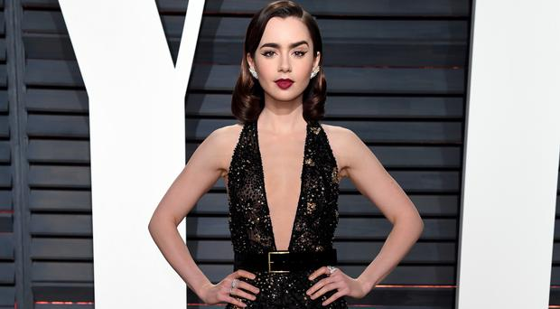 Lily Collins says she has forgiven her father Phil