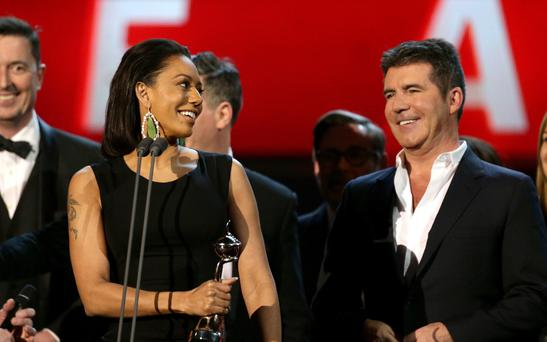 Mel B Says Simon Cowell Convinced Her to Leave Her Estranged Husband