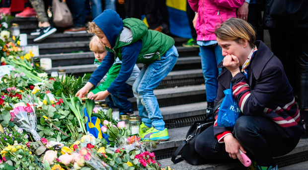 A woman at the memorial to victims in Stockholm, Sweden