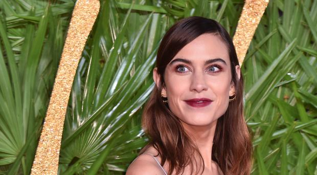 Alexa Chung has only been in romantic relationships with men up until now (Matt Crossick/PA)