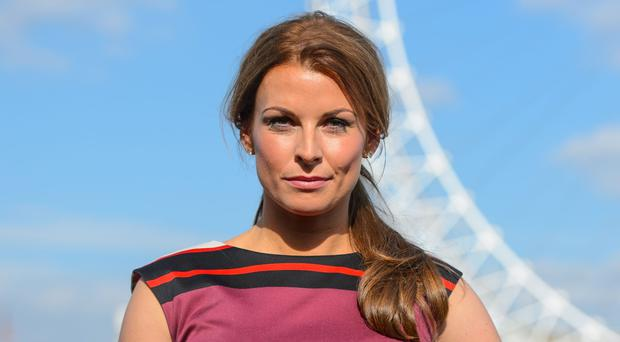 Coleen Rooney shares first picture of baby son Cass (Dominic Lipinski/PA)