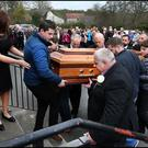 Big Tom McBride's remains arrive for public reposal at Oram Community Centre in Castleblaney