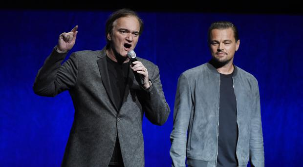 Quentin Tarantino, left and Leonardo DiCaprio promoted their new collaboration (Photo by Chris Pizzello/Invision/AP)