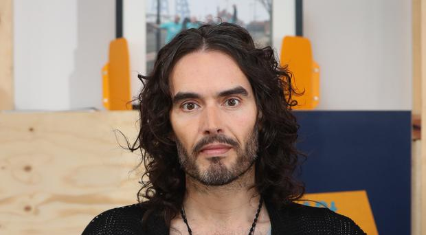Russell Brand scraps tour after his mum is badly hurt in crash