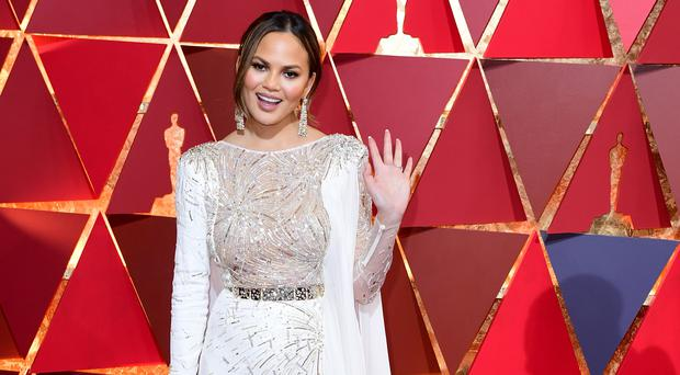 Chrissy Teigen has posted an adorable video of her bathing her two-year-old daughter, Luna (Ian West/PA)
