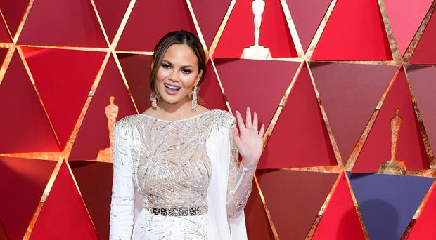 Chrissy Teigen shared the adorable family picture on Instagram (Ian West/PA)