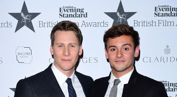 Tom Daley's husband, Dustin Lance Black, took the couple's newborn son to work with him (Ian West/PA)