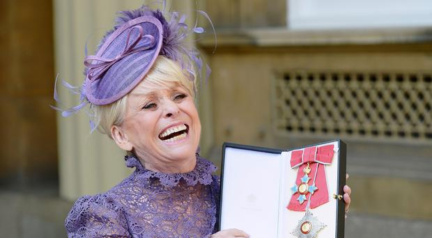 Television star Barbara Windsor after she was made a Dame Commander of the order of the British Empire by Queen Elizabeth II during an Investiture ceremony at Buckingham Palace, London.
