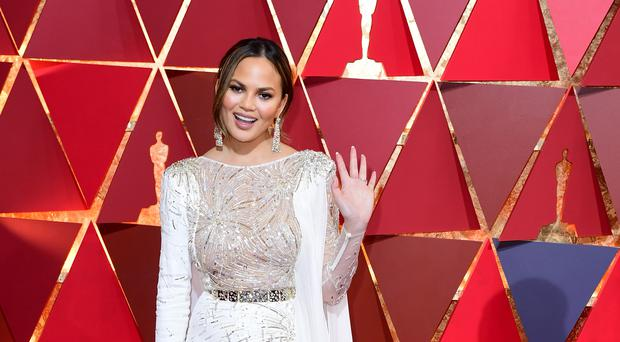 Chrissy Teigen 'queen of the bugs' after playing with large tarantula hawk wasp (Ian West/PA)
