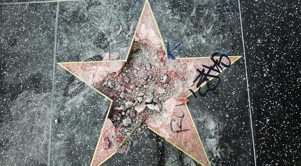 A man has been charged with vandalising Donald Trump's star on the Hollywood Walk Of Fame (AP Photo/Reed Saxon)
