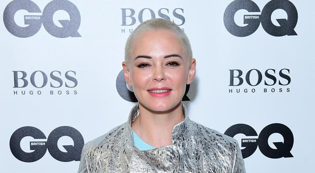 Rose McGowan became the first woman to win the Inspiration prize at the GQ awards (Ian West/PA)