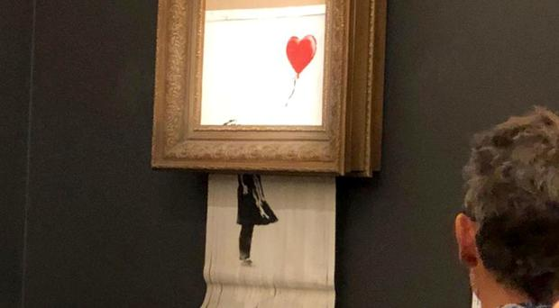 The buyer of a Banksy artwork partially shredded moments after the auction finished will go through with the sale (Sotheby's/PA)