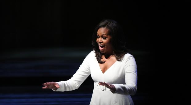 Michelle Obama acknowledges the crowd at the Royal Festival Hall (PA)