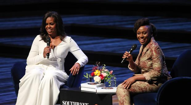 Michelle Obama (left) in conversation with writer Chimamanda Ngozi Adichie (PA)