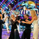 Strictly Come Dancing winners Stacey Dooley and Kevin Clifton celebrate with the glitterball trophy