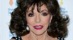 Dame Joan Collins was among the celebrity users to notice the issue (Ian West/PA)