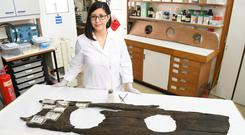 Conservator Luisa Duarte with the 12th century triple toilet seat (Matt Crossick/PA)