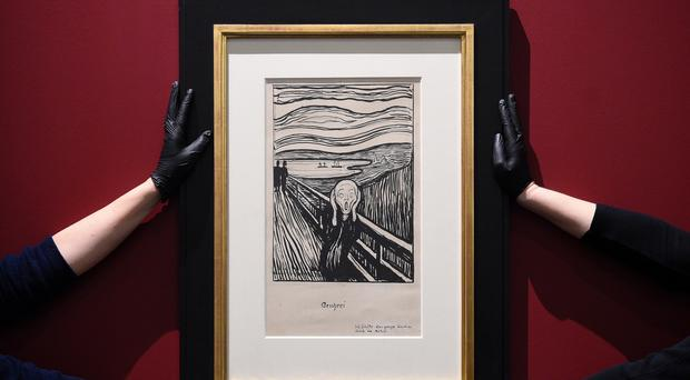 Gallery technicians install Edvard Munch's The Scream at the British Museum in London (Kirsty O'Connor/PA)