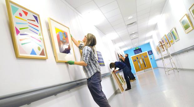 The Paintings in Hospitals team at work at Queen Elizabeth Hospital Birmingham (Painting in Hospitals/PA)