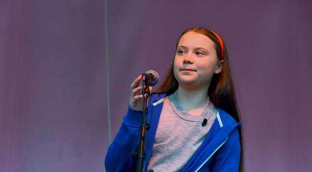 16-year-old Swedish climate activist Greta Thunberg addresses the Extinction Rebellion demonstrators at Marble Arch in London (PA)