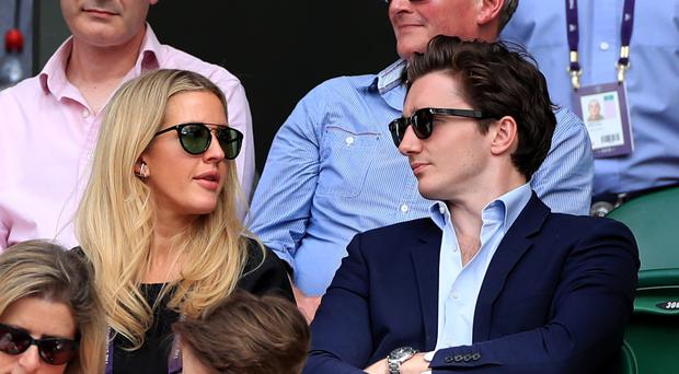 Ellie Goulding and Caspar Jopling watch the centre court action on day eight of the Wimbledon Championships (Mike Egerton/PA)