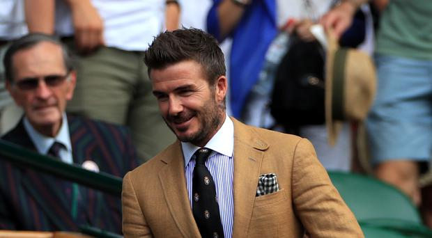 David Beckham in the royal box on day ten of the Wimbledon Championships at the All England Lawn Tennis and Croquet Club, Wimbledon.