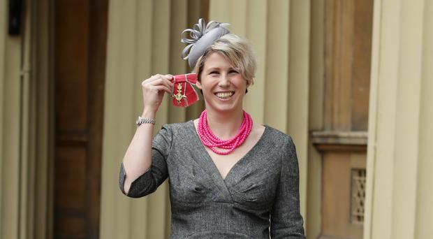 Caroline Criado-Perez at Buckingham Palace after she was made an OBE by the Prince of Wales (Yui Mok/PA)