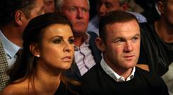 Wayne Rooney and Coleen at Manchester Arena (Richard Sellers/PA)