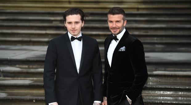 David Beckham (right) and his son Brooklyn (Kirsty O'Connor/PA)