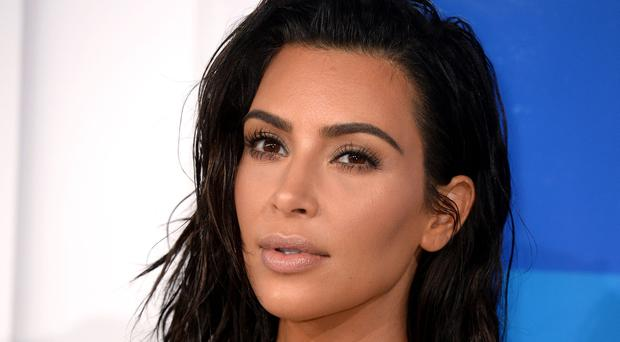 Kim Kardashian channelled Reese Witherspoon for the video (PA)
