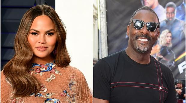 Chrissy Teigen jokingly apologised to husband John Legend after Idris Elba replied to her throwback challenge (PA)