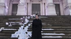 Artist Anne Hardy standing next to her artwork at Tate Britain (Tate Britain/PA)