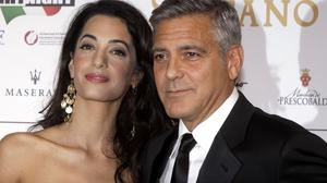 George Clooney and his fiancee Amal Alamuddin are not getting married in London