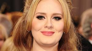 Adele has taken to Twitter to deny rumours she has split from her partner