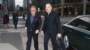 Sir Elton John and David Furnish arrive at the Victoria Palace Theatre in central London for a special celebration as the musical Billy Elliot closes