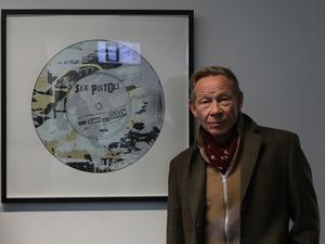 Paul Cook with Simon Freeborough's artwork named Sex Pistols (Gold) (Luciana Guerra/PA)