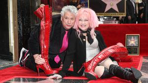 Harvey Fierstein and Cyndi Lauper at the ceremony honouring them with stars on the Hollywood Walk of Fame (AP)