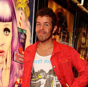 Perez Hilton has announced that he is a dad for the first time