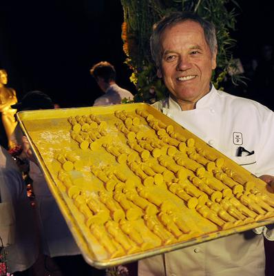 Chef Wolfgang Puck poses with chocolate Oscar statues, which will be served up at this year's Governors Ball (AP)
