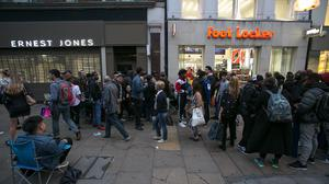 People queuing at a Foot Locker shop in Oxford Street, London, waiting for the release of the Adidas Yeezy Boost 350