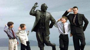 Archive image of the grandchildren of Eric Morecambe with a statue of the star on Morecambe Promenade . Searches for homes to buy in Morecambe have surged by 71% in the space of a week, according to Rightmove (John Giles/PA)