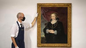 A Sotheby's technician with a rediscovered Rubens portrait (Victoria Jones/PA)